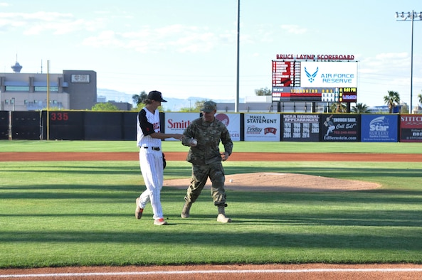 Master Sgt. Dustin Watson, a dedicated crew chief in the 926th Aircraft Maintenance Squadron, threw out the first pitch at a UNLV Rebels baseball game April 26 against San Diego State at Earl E. Wilson Stadium. Watson was named Crew Chief of the Year for the Air Force Reserve Command earlier this month. (U.S. Air Force photo by Maj. Candice Allen)