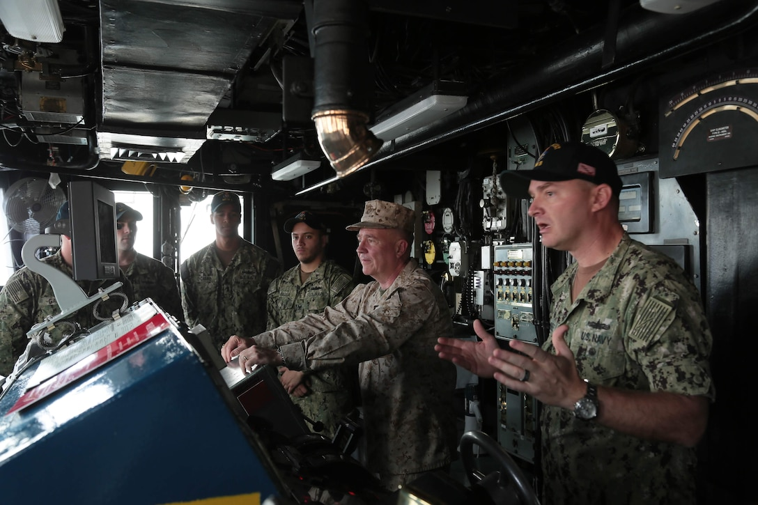 U.S. Marine Corps Gen. Kenneth F. McKenzie Jr., U.S. Central Command commander, tours the bridge of Avenger class mine countermeasure ship USS Sentry (MCM 3), part of Commander, Task Force (CTF) 52, Manama Bahrain, April 26, 2019. The MCM force enhances mine-hunting capabilities in searching, identifying and neutralizing mines threatening the freedom of navigation and the free flow of commerce. (U.S. Army photo by Sgt. Franklin Moore)