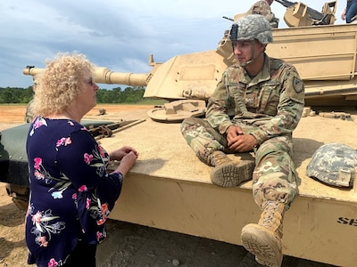 Ms. Kris Thomasian is a school board member on the  Murrieta Valley Unified District Board of Education in Murrieta, CA., She took a few moments to chat with a Soldier during a military vehicle static display.