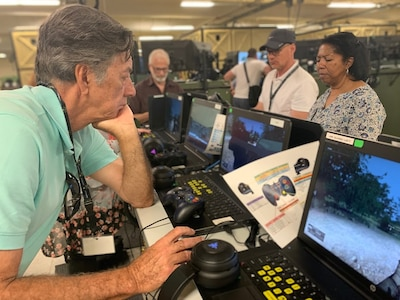 Mr. Bob Tyra, a contract consultant for the Los Angeles County Office of Education checks out the new simulation systems during the Army Educator Tour.