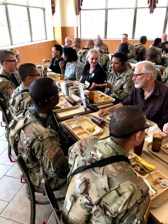 Attendees of the Army Educator Tour had lunch with Soldiers at a dining facility.