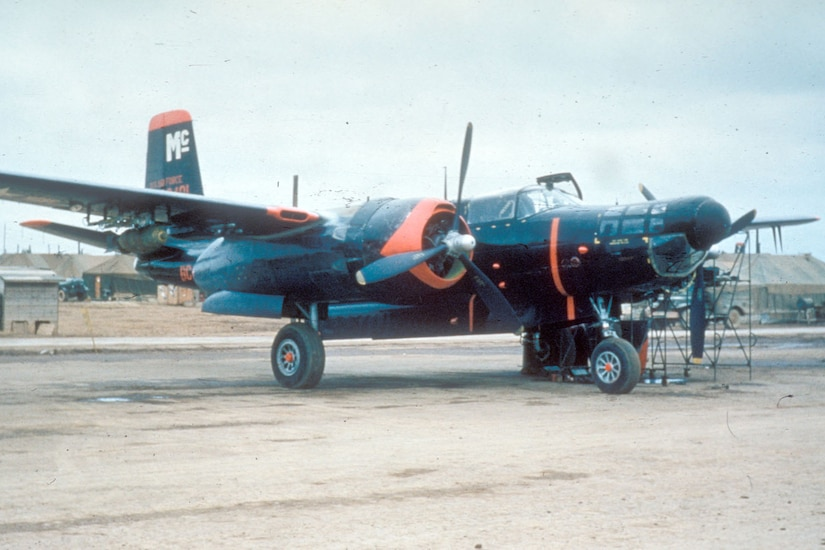 A B-26 Invader sits on an airfield.