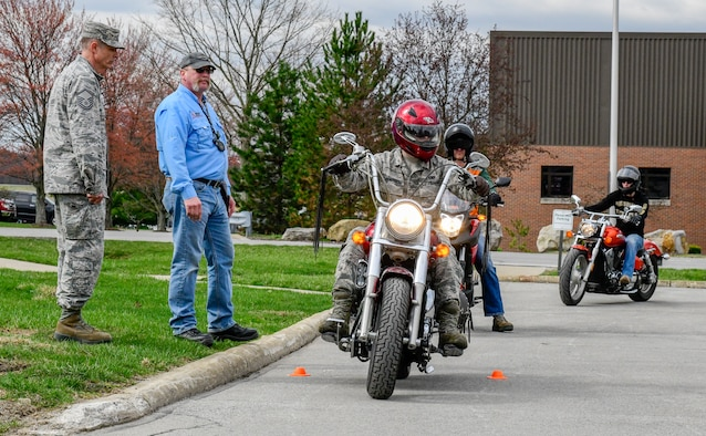 Andy Ford, occupational safety manager assigned to the 910th Airlift Wing, and Master Sgt. Phil Walsh, aircrew flight supervisor assigned to the 910th Operations Support Squadron, observe motorcycle safety course participants on April 12, 2019, at a parking lot in YARS.