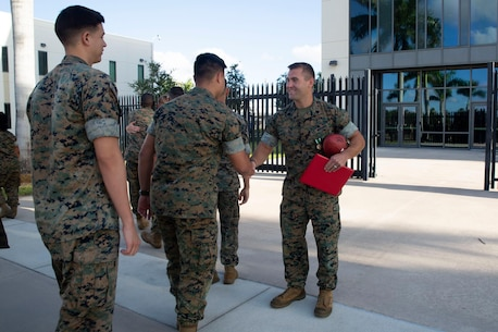 SSgt Zachary A. Fry shakes hands with U.S. Marine Corps Forces, South staff after getting the Mavy and Marine Corps Commendation Medal as his end of tour award, April 30, 2019.