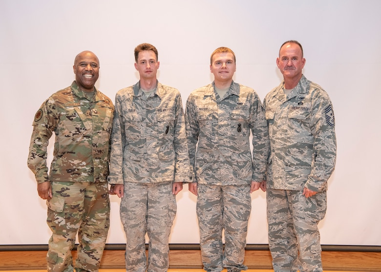 Brig. Gen. Christopher Walker, Assistant Adjutant General - Air; Sgt. Gregory Fuqua, West Virginia Air National Guard (WVANG) NCO of the Year; Senior Airman Christopher Marcum, WVANG Airman of the Year; and Command Chief Master Sgt. David Stevens, pose for a photo at the conclusion of the 2019 Best Warrior Competition held April 26-28, 2019, at Camp Dawson in Kingwood, W.Va. More than 22 Soldiers and Airmen from West Virginia and the District of Columbia participated in the three-day event designed to measure a Soldier or Airman's physical abilities, leadership skills, teamwork and critical thinking while completing basic and advanced core warrior competencies. (U.S. Army National Guard Photo by Bo Wriston)