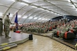 U.S. Army Soldiers fill the USO theater at Camp Buehring, Kuwait, in preparation for a transfer of authority ceremony Apr. 29, 2019. The 1st. Battalion, 108th Aviation Regiment, Kansas Army National Guard, provided aviation support to the 35th Combat Aviation Brigade, Missouri Army National Guard and its subordinate units during their 2018-2019 deployment to the Middle East, supporting Operations Inherent Resolve and Spartan Shield.