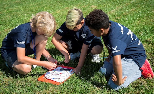 (From left) STEM Aerospace campers Sam Theil, Rylen Dellinger and Alex Grubb explore solar energy in a hands on activity at a two-day STARBASE camp July 11, 2018.
