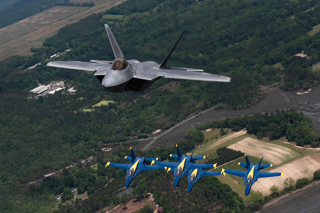 F-22s with Blue Angels