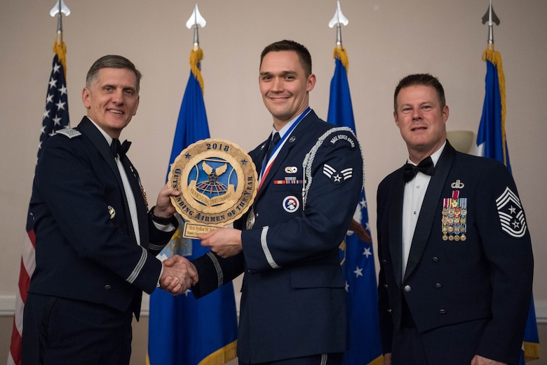 U.S. Air Force Senior Airman Dyllon M. Schwartz (middle), 28th Aircraft Maintenance Squadron honor guard flight trainer at Ellsworth Air Force Base, S.D., receives an Air Force Global Strike Outstanding Airmen of the Year award April 15, 2019, at Barksdale Air Force Base, La. The OAY award was awarded to six Airmen throughout AFGSC. (U.S. Air Force photo by Airman Jacob B. Wrightsman)