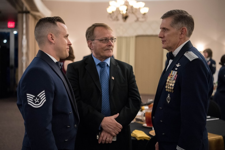 U.S. Air Force Tech. Sgt. Joshua D. White (left), 509th Force Support Squadron non-commissioned officer-in-charge of the base honor guard at Whiteman Air Force Base, Mo., and his father (middle) talk to Gen. Timothy Ray (right), Air Force Global Strike Command commander, at the AFGSC Outstanding Airmen of the Year award ceremony April 15, 2019, at Barksdale Air Force Base, La. The ceremony was hosted in honor of six Airmen who were selected as the most outstanding Airmen throughout AFGSC. (U.S. Air Force photo by Airman Jacob B. Wrightsman)