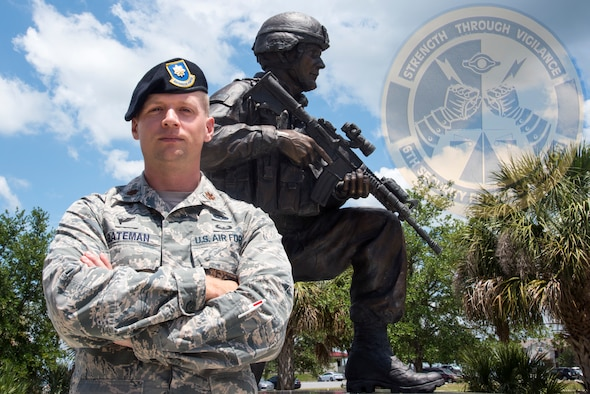 U.S. Air Force Maj. Jay Bateman, the 6th Security Forces Squadron Director of Operations, poses for a photo by the Helton Hall statue at MacDill Air Force Base, Fla., May 2, 2019.