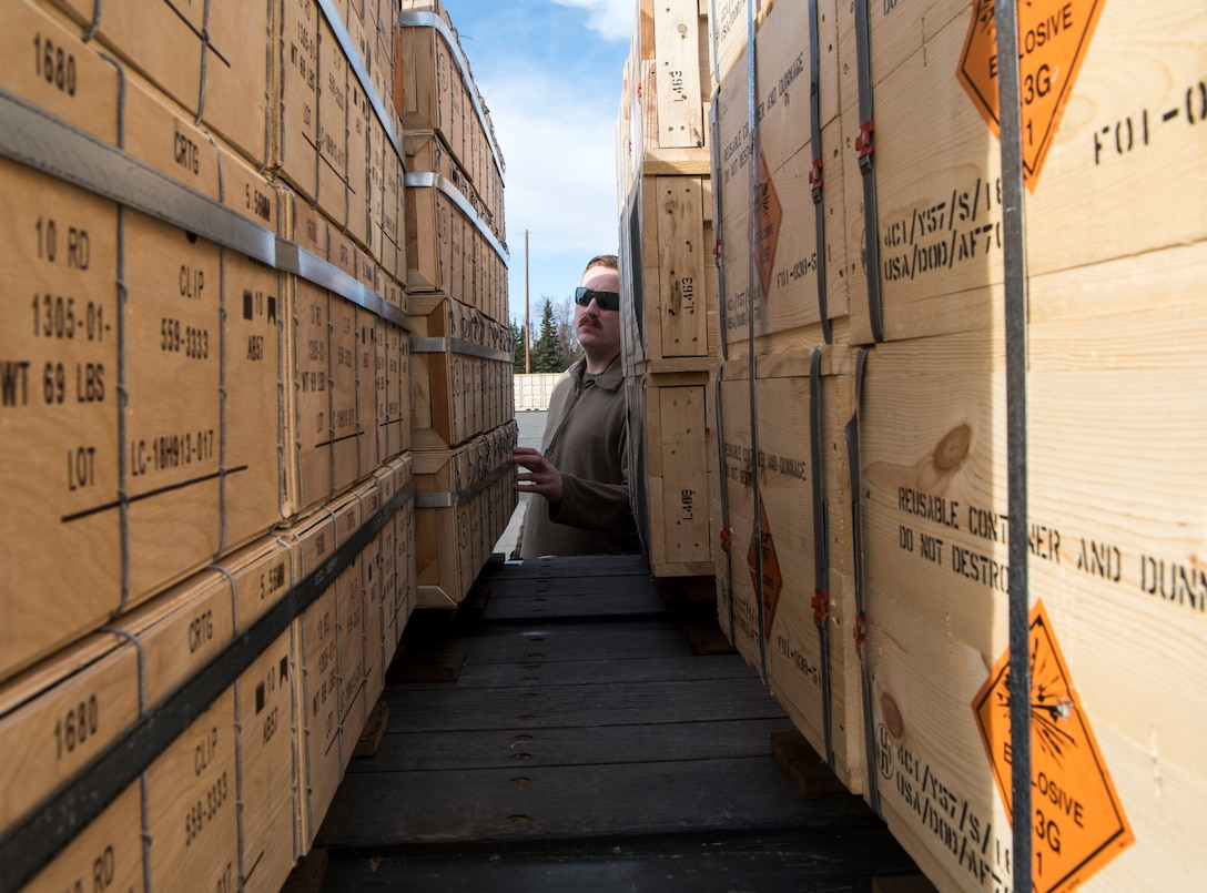U.S. Air Force Tech. Sgt. Colten Mullins, 3rd Munitions Squadron senior munitions inspector, conducts an inspection during the Spring Ammunition Barge arrival at Joint Base Elmendorf-Richardson, Alaska, April 24, 2019. The ammo barge contained six containers and over 50,000 pounds of munitions.