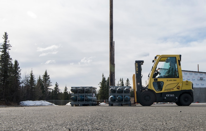 U.S. Air Force Senior Airman Brendon Malone, 3rd Munitions Squadron munitions stockpile management crew chief, prepares to move inert MK82 500-pound bomb bodies with an all-terrain forklift during the Spring Ammunition Barge arrival at Joint Base Elmendorf-Richardson, Alaska, April 24, 2019. The ammo barge contained six containers and over 50,000 pounds of munitions.