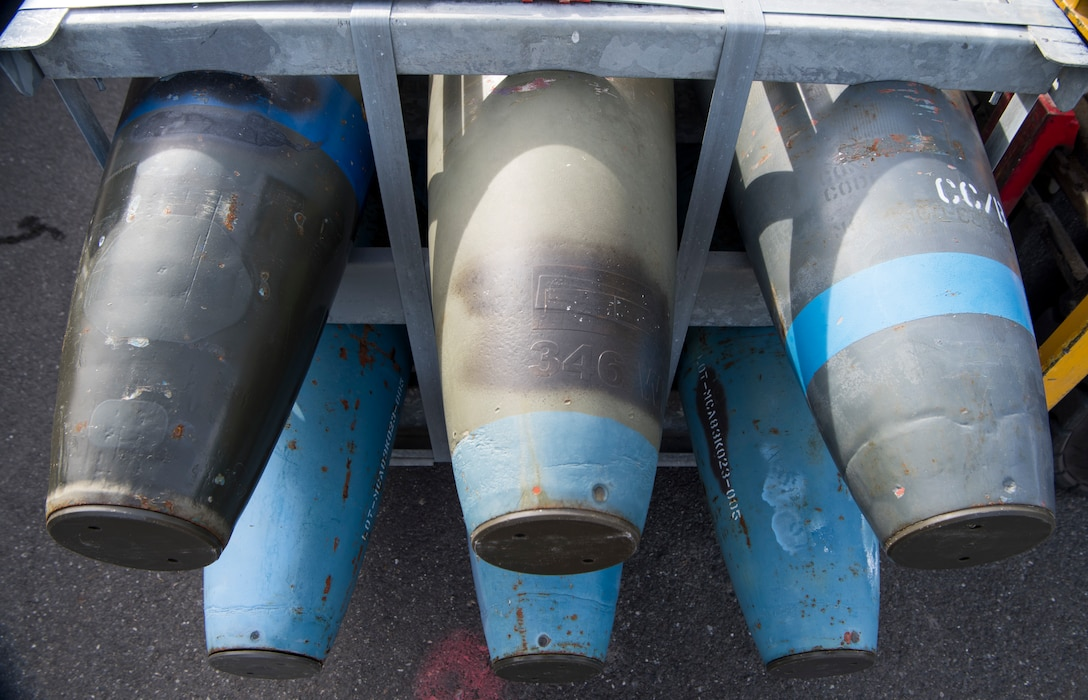 Inert MK82 500-pound bomb bodies await storage during the Spring Ammunition Barge arrival at Joint Base Elmendorf-Richardson, Alaska, April 24, 2019. The ammo barge contained six containers and over 50,000 pounds of munitions.