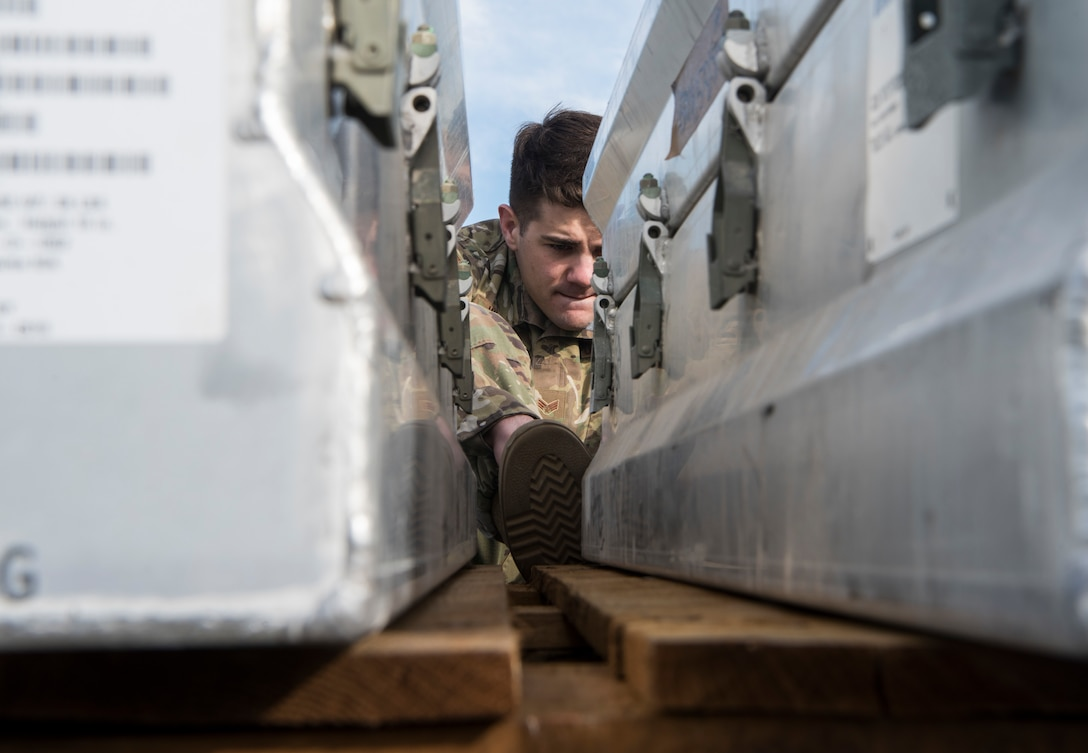 U.S. Air Force Senior Airman Gabriel Walker, 3rd Munitions Squadron munitions stockpile management crew chief, reads serial numbers during the Spring Ammunition Barge arrival at Joint Base Elmendorf-Richardson, Alaska, April 24, 2019. The ammo barge contained six containers and over 50,000 pounds of munitions.