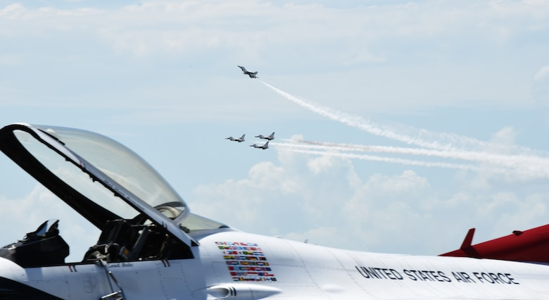 The Air Force Thunderbirds perform a flyover before landing at the Combat Readiness Training Center in Gulfport, Mississippi, May 2, 2019.