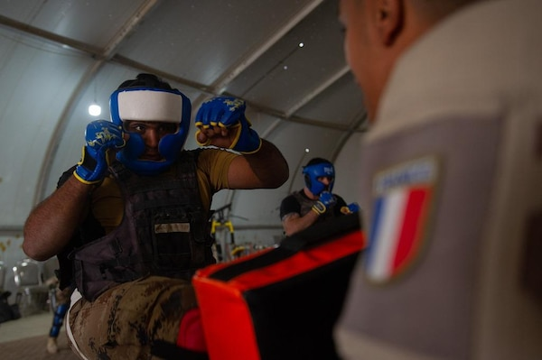 Task Force Narvik personnel conduct a High Intensity Close Combat Training course at the Iraq Counter-Terrorist Defense Academy. The objective of the course is to train Iraqi cadres in close combat so they can in turn train their soldiers.