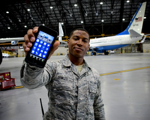 "Maintainers of C-40C aircraft need a variety of physical tools in their toolboxes to work on planes.  For keeping up with unit news, Senior Airman Aaron Bowles, 932nd Airlift Wing Maintenance Squadron, shows off his latest hand held tool, the ""932nd Airlift Wing Mobile App"" on May 1, 2019, at Scott Air Force Base, Illinois."