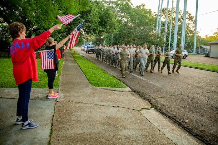 Marines and Airmen conduct a motivational run at Crystal Springs, Miss., on April 26, 2019. The Marines and Airmen are part of the Department of Defense's Innovative Readiness Training Camp Kamassa near Crystal Springs. The program supports the community by pairing military members with civil projects that benefit the community, and enables Marine Reserve units to increase their efficiency and performance. (U.S. Marine Corps photo by Lance Cpl. Jose Gonzalez)