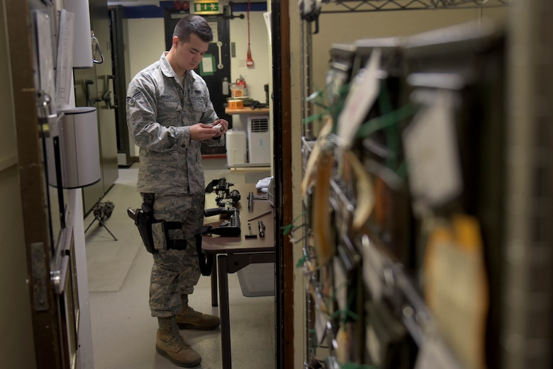 U.S. Air Force Senior Airman William Fruchey, 100th Security Forces Squadron armorer, cleans an M-4 carbine in the armory at RAF Mildenhall, England, May 2, 2019. All weapons are cleaned after each use. (U.S. Air Force photo by Senior Airman Benjamin Cooper)