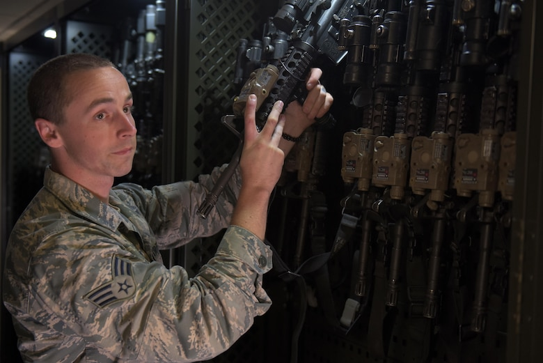 U.S. Air Force Senior Airman Christopher Francis, 100th Security Forces Squadron armorer, retrieves an assigned weapon in the armory at RAF Mildenhall, England, May 2, 2019. Each Security Forces flight member has an assigned M-4 carbine and M-9 Beretta specific to that Airman. (U.S. Air Force photo by Senior Airman Benjamin Cooper)