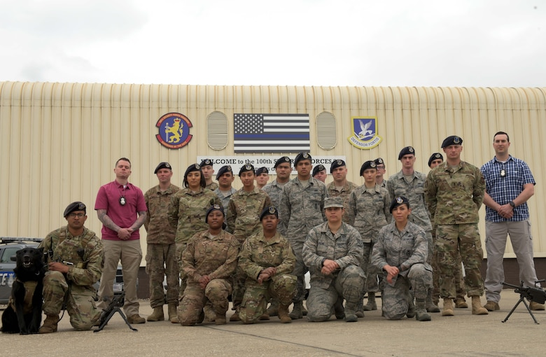 Members of the 100th Security Forces Squadron pose for a photo at RAF Mildenhall, England, May 2, 2019. Security Forces is a diverse career field that encompasses several different duties such as: military working dog handlers, investigations and patrol. (U.S. Air Force photo by Senior Airman Benjamin Cooper)