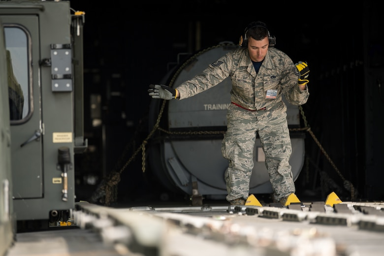 Tech. Sgt. Patrick Lerman, 70th Aerial Port Squadron air transportation specialist, Homestead Air Force Base, Fla, competes in the Halvorsen 25K Loader Obstacle Course