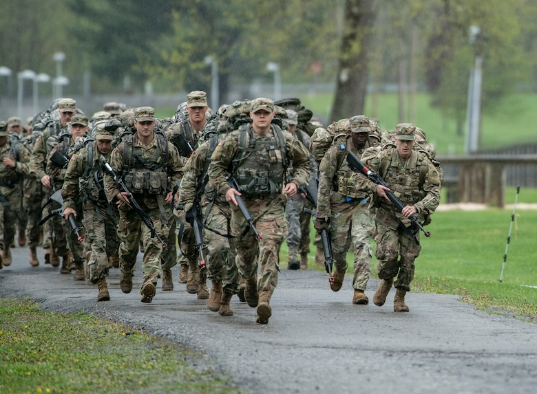 Soldiers and Airmen take off running for a six-mile ruck march