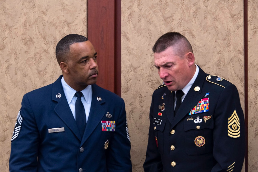 Chief Master Sgt Timothy White Jr., Senior Enlisted Advisor to the Chief of the Air Force Reserve, Pentagon, Washington D.C. and Command Chief Master Sergeant of Air Force Reserve Command, Robins Air Force Base, Georgia speaks with Command Sgt Maj Christopher Kepner, Senior Enlisted Advisor to the Chief of the National Guard Bureau before breakfast at the House National Guard and Reserve Component Caucus Breakfast at the U.S Capitol, Washington D.C., April 30, 2019. (U.S. Air Force photo by SrA Andreaa Phillips)