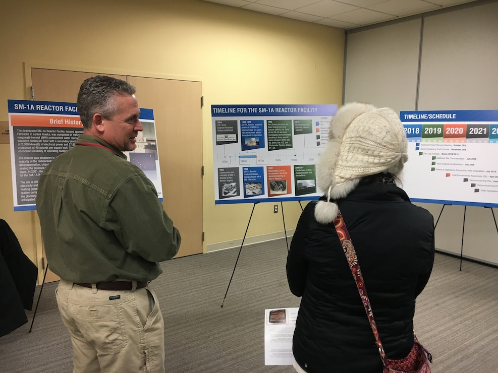 U.S. Army Corps of Engineers Radiological Health Physicist Hans Honerlah speaks with a member of the Fort Greely community at an on-post community update meeting Tuesday evening April 23, 2019, where Fort Greely stakeholders had an opportunity to learn more about the planning for the decommissioning of the SM-1A deactivated nuclear power plant. The SM-1A project team is committed to transparently sharing accurate information in a timely manner throughout the course of the project and among all relevant parties, making sure concerns among stakeholders are quickly addressed.