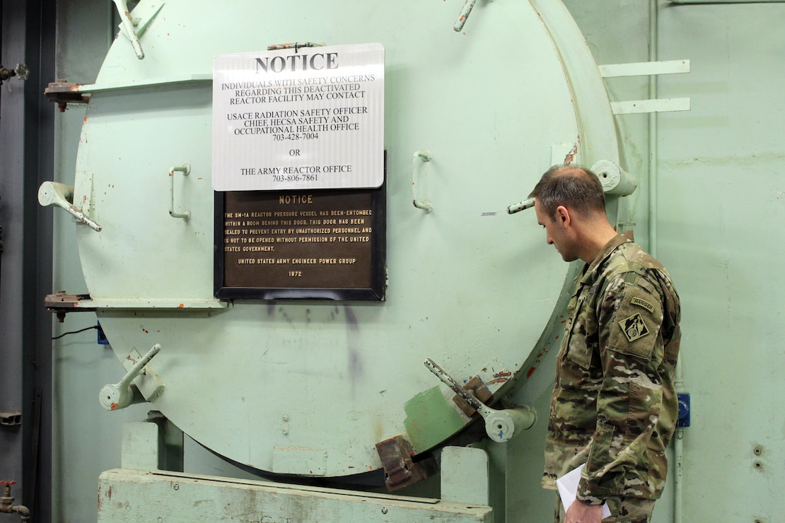 U.S. Army Corps of Engineers, Baltimore District commander Col. John Litz examines the containment vessel door of the SM-1A Deactivated Nuclear Power Plant April 24, 2019 during a site visit. SM-1A will be decommissioned and dismantled by the U.S. Army Corps of Engineers, Baltimore District, with its Radiological Center of Expertise, and in partnership with Fort Greely Garrison and Alaska District. Part of this dismantling and decommissioning effort will involve segregating components of the co-located, still operational steam plant from where the decommissioning will take place.