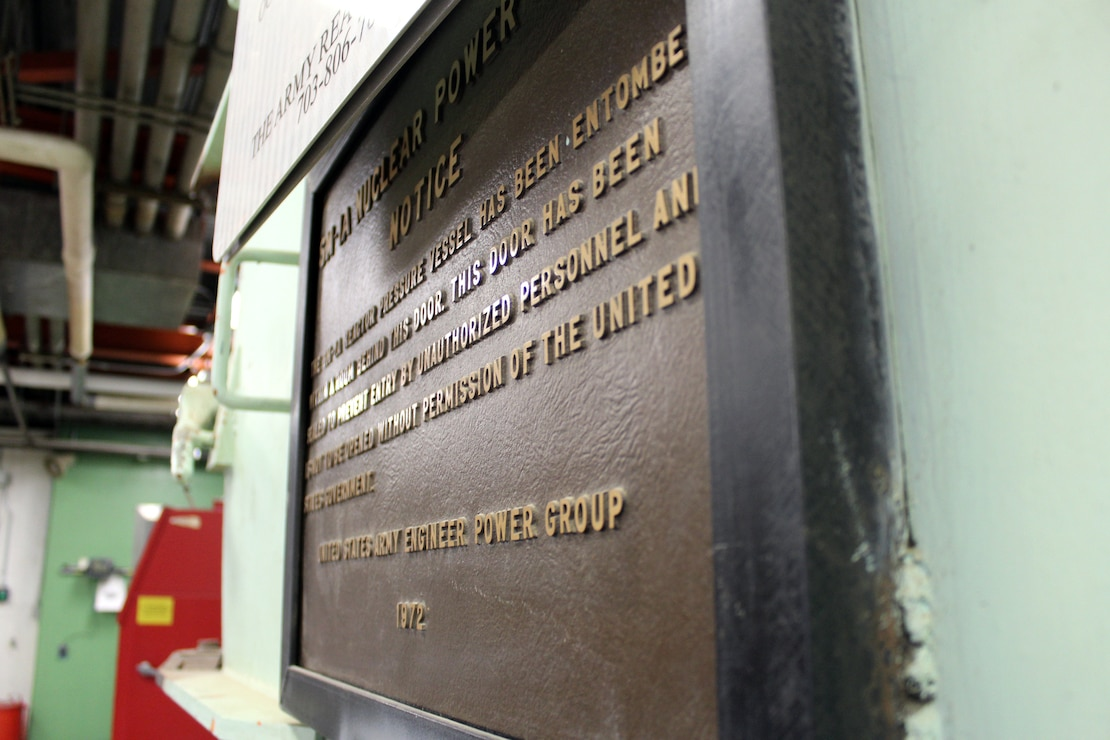 A plaque signifying the SAFSTOR of the containment vessel of the SM-1A Deactivated Nuclear Power Plant is featured during a site tour April 24, 2019. Located at Fort Greely, the SM-1A Deactivated Nuclear Power Plant is in the planning stage of being decommissioned and dismantled. Part of this effort will involve segregating components of the co-located, still operational steam plant from where the decommissioning will take place. U.S. Army Corps of Engineers, Baltimore District, with its Radiological Center of Expertise, and Alaska District personnel are working together closely in partnership on the SM-1A decommissioning at Fort Greely in Alaska.