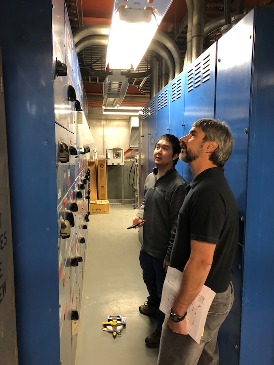 U.S. Army Corps of Engineers, Alaska District Electrical Engineer Zachary Sam and Chief of Mechanical Engineering Brent Goering check out switch boxes Wednesday April 24, 2019 at the facility where the final decommissioning of the SM-1A deactivated nuclear power plant will take place. Part of the effort will involve segregating components of the co-located, still operational steam plant from where the decommissioning will take place. U.S. Army Corps of Engineers, Baltimore District, with its Radiological Center of Expertise, and Alaska District personnel are working together closely in partnership on the SM-1A decommissioning at Fort Greely in Alaska.