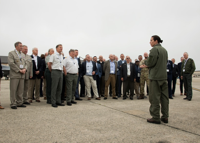 Members of the International Conference on Employer Support of the Reserves, listen as an F/A-18 Hornet pilot shares information on the jet during a tour of the Joint Base Andrews flight line, May 1, 2019. This tour marks the first time the United States has ever hosted the ICESR event. (U.S. Air Force photo by Staff Sgt. Cierra Presentado)