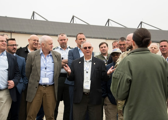Members of the International Conference on Employer Support of the Reserves ask questions about military operations during a tour of the Joint Base Andrews flight line, May 1, 2019. The ICESR is a biennial event that brings together Reserve Forces Leaders, employers, government and non-government partners, and other stakeholders from around the globe. (U.S. Air Force photo by Staff Sgt. Cierra Presentado)
