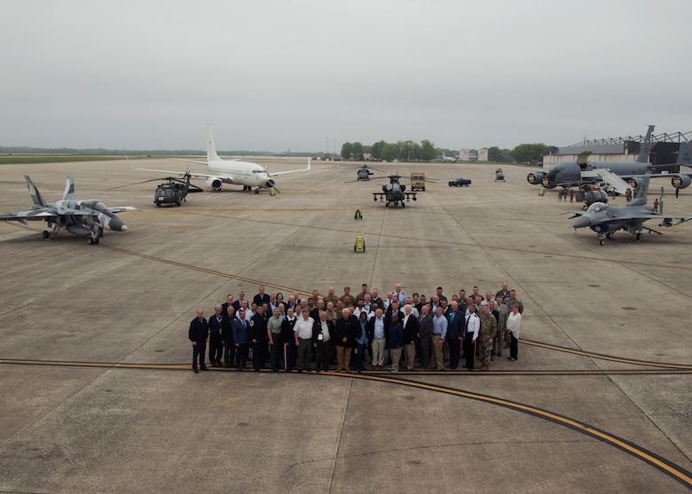 Members of the International Conference on Employer Support of the Reserves pose for a group photo during a tour of the Joint Base Andrews flight line, May 1, 2019. The ICER is a biennial event that brings together Reserve Forces Leaders, employers, government and non-government partners, and other stakeholders from around the globe. (U.S. Air Force photo by Staff Sgt. Cierra Presentado)