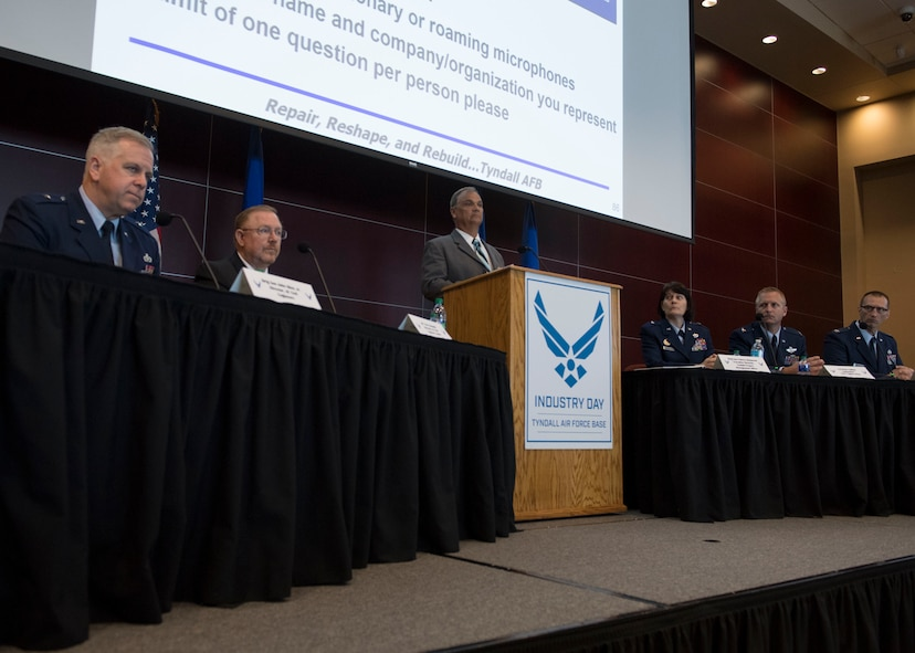 Seated from left to right, Brig. Gen. John Allen Jr., Air Force Director of Civil Engineers, Terry Edwards, Air Force Civil Engineer Center director, Brig. Gen. Patrice Melançon, Tyndall Program Management Office executive director, Col. Brian Laidlaw, 325th Fighter Wing commander, and Col. Brent Hyden, Tyndall PMO director, participate in a discussion panel May 2, 2019, during the second industry day held to provide updates and future plans for rebuilding the base that was destroyed by Hurricane Michael Oct. 10, 2018. (U.S. Air Force photo by Airman 1st Class Monica Roybal)