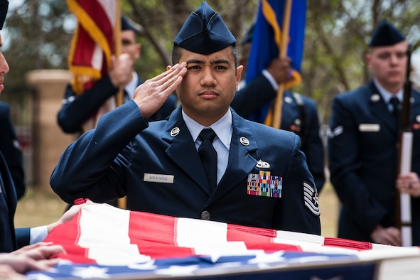 Tech. Sgt. James Balajadia, 27th Special Operations Wing base Honor Guard noncommissioned officer in charge, renders a salute while participating in a mock funeral at Cannon Air Force Base, N.M., April 17, 2019. To showcase everything they had learned, the Cannon AFB Honor Guard team performed an active duty funeral in front of base personnel. (U.S. Air Force photo by Senior Airman Lane Plummer)