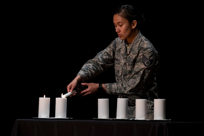 Staff Sgt. Cheree Voto, 628th Aerospace Medicine Squadron aerospace medic, lights a candle in remembrance of the Holocaust for Holocaust Remembrance Week May 2, 2019, at Joint Base Charleston, S.C.