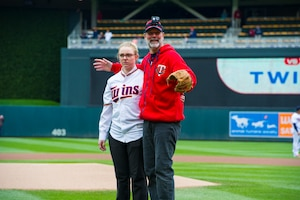 Staff Sgt. Sydney Whiteis, assigned to the 934th Security Forces Squadron, threw out the ceremonial first pitch before the start of the Minnesota Twins Major League Baseball game against the Houston Astros at Target Field in Minneapolis, Minn., May 2, 2019.  Two hours before the game, Whiteis was surprised to learn she was selected to throw out the opening pitch.