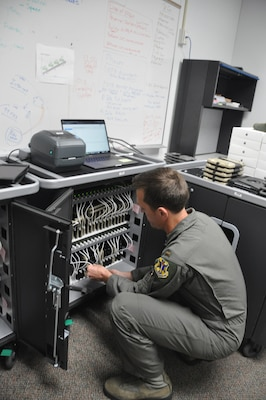 2nd Lt. Lucas Erickson, 12th Training Squadron student pilot and electronic flight bag technician, organizes iPad tablets in a specialized charging and upload cabinet, May 3, 2019, Joint Base San Antonio-Randolph, Texas. The team at 12th TRS uses this equipment to expedite the issue and maintenance of the EFB inventory across JBSA-Randolph.