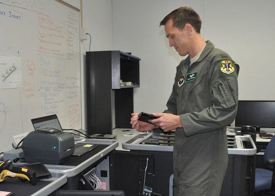 2nd Lt. Lucas Erickson, 12th Training Squadron student pilot and electronic flight bag technician, digitally issues an iPad tablet, used as an EFB by aircrew flying out of Joint Base San Antonio-Randolph, Texas, May 3, 2019. EFBs increase situational awareness in the cockpit and allow aviators to access critical mission data immediately, instead of searching through traditional paper flight publications.