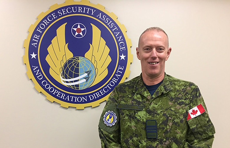 Lt. Col. Jean-Francois Harvey of Canada serves as lead representative of the foreign liaison officers, part of the Air Force Life Cycle Management Center's Air Force Security Assistance and Cooperation Directorate, headquartered at Wright-Patterson Air Force Base. (Skywrighter photo/Amy Rollins)