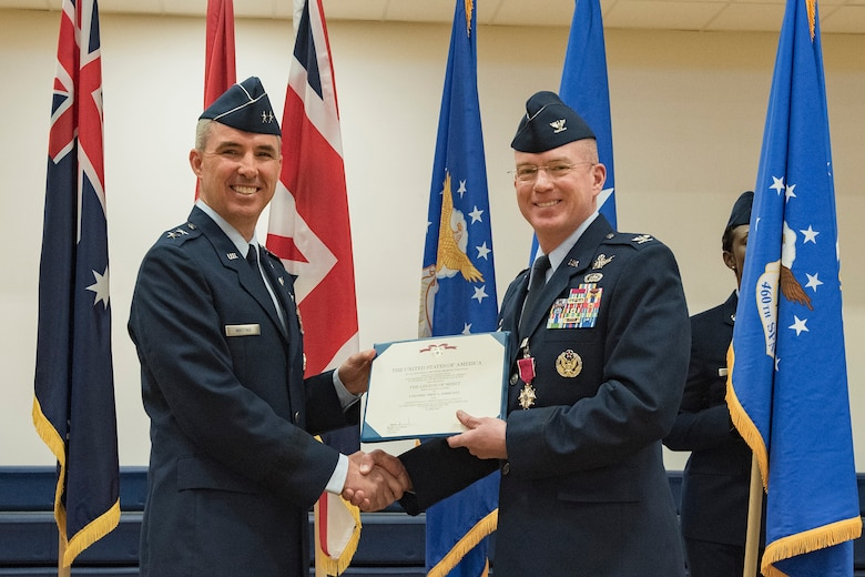 Maj. Gen. Stephen Whiting, 14th Air Force commander, presents the Legion of Merit medal to Col. Troy Endicott, 460th Space Wing outgoing commander, at the 460th SW change of command ceremony May 3, 2019, on Buckley Air Force Base, Colorado.