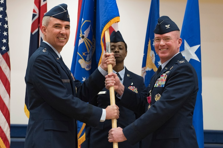 Maj. Gen. Stephen Whiting, 14th Air Force commander, receives the guidon from Col. Troy Endicott, 460th Space Wing outgoing commander, during a change of command ceremony May 3, 2019, on Buckley Air Force Base, Colorado.