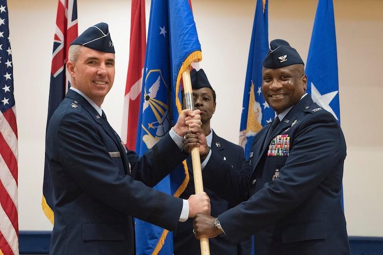 Maj. Gen. Stephen Whiting, 14th Air Force commander, presents the guidon to Col. Devin Pepper, 460th Space Wing commander, during a Change of Command ceremony May 3, 2019, on Buckley Air Force Base, Colorado.