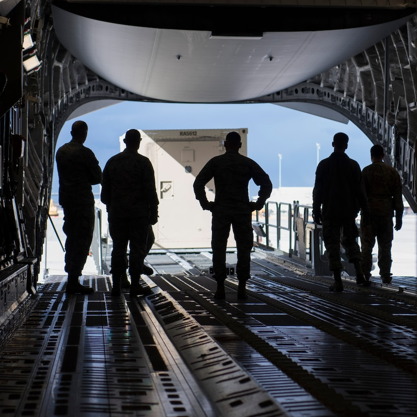 Airmen watch a Rapid Assistance Support for Calibration (RASCAL) load onto a C-17 Globemaster III Jan. 17, 2019, at Mountain Home Air Force Base, Idaho. The RASCAL, which is one of two of its kind in the Air Force, is deploying for the first time in 10 years. (U.S. Air Force photo by Airman First Class Andrew Kobialka)
