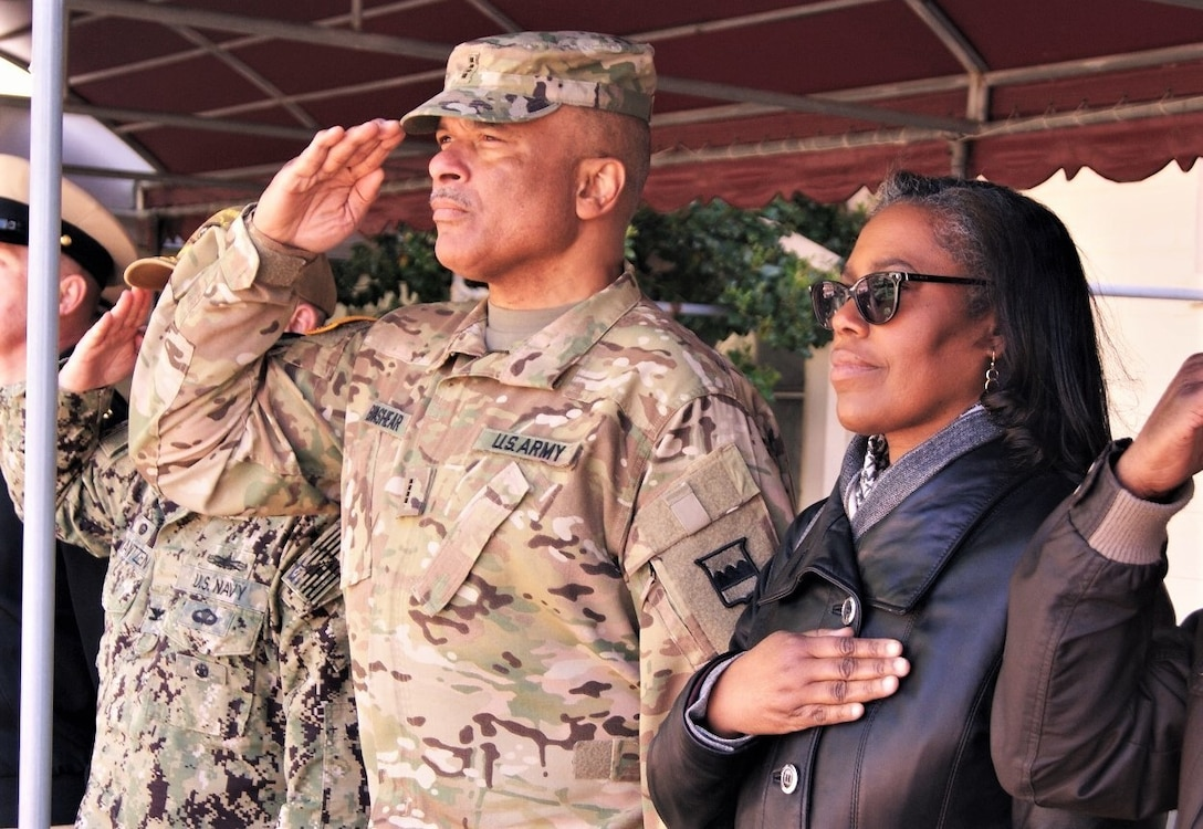 (Left to right) Chief Warrant Officer 4 Phillip Brashear, the command CWO for the 80th Training Command (TASS), and his wife Sandra attend the Brashear Conference Center flag-raising ceremony at Joint Expeditionary Base Little Creek-Fort Story, Virginia, April 1, 2019, honoring his late father Master Chief Boatswain's Mate Carl Maxie Brashear.