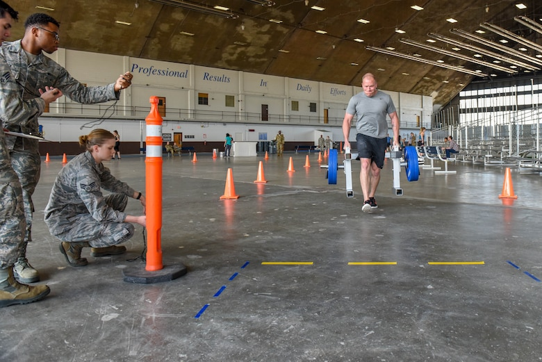 Tech. Sgt. Dustin Jespersen, a 28th Operations Squadron survival, evasion, resistance and escape specialist, performs a farmer's carry during the Ellsworth Air Force Base's Strongest Competition at the Pride Hangar on Ellsworth AFB, S.D., April 25, 2019. The free event was hosted by the 28th Force Support Squadron. Competitors performed feats of strength throughout five different exercises: max-out deadlift, farmer's carry, keg run, tire flip and vehicle pull. Jespersen placed first as the strongest male. (U.S. Air Force photo by Tech. Sgt. Jette Carr)