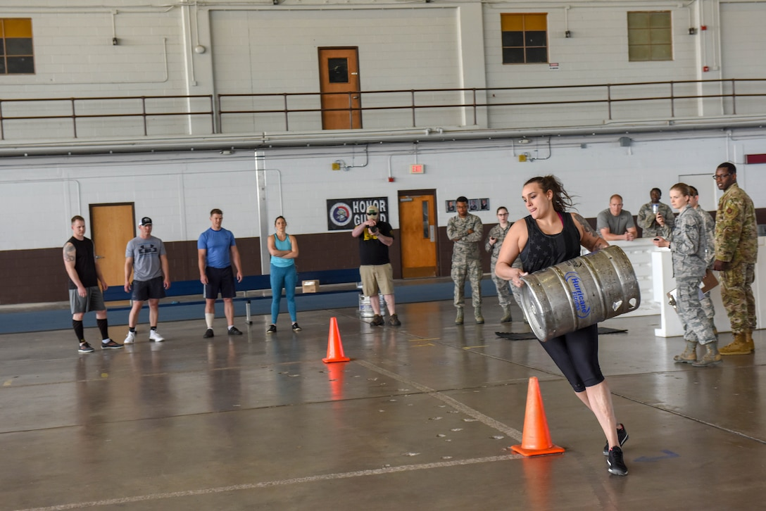 Staff Sgt. Brittany Binder, the 28th Force Support Squadron Fitness Assessment Cell noncommissioned officer in charge, runs while carrying a full-barrel keg during the Ellsworth Air Force Base's Strongest Competition at the Pride Hangar on Ellsworth AFB, S.D., April 25, 2019. Half full of sand, the keg weighed between 60-70 pounds. Binder, who placed second in the female division, decided to compete because she wanted a new challenge that would bring her out of her comfort zone. (U.S. Air Force photo by Tech. Sgt. Jette Carr)